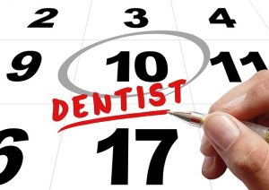 Your dentist in Holly Springs reminds customers to use their dental insurance