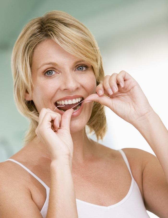 flossing-teeth-cary-dentist